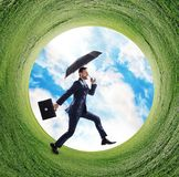 Businessman running into green grass circle. Royalty Free Stock Photos