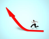 Businessman running on growing red arrow Royalty Free Stock Photography