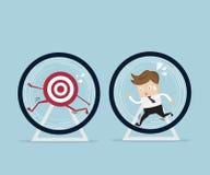 Businessman running in hamster wheel Stock Photo