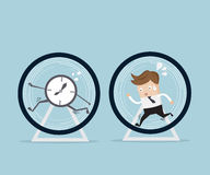 Businessman running in hamster wheel Royalty Free Stock Images