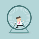 Businessman running in a hamster wheel Stock Images