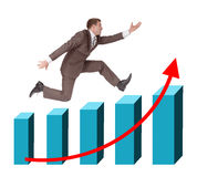 Businessman running with hand forward on graph Stock Image