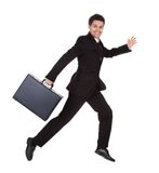 Businessman running with his briefcase. Successful businessman running with his briefcase hurrying along to an appointment full of energy  on white Royalty Free Stock Photo