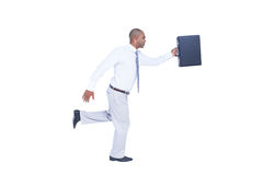 Businessman running and holding briefcase Royalty Free Stock Photography