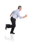 Businessman running in a hurry. Isolated on white Royalty Free Stock Photos
