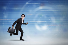 Businessman running inside cyberspace Royalty Free Stock Photos