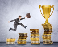 Businessman running and jumping on money stairs Stock Image