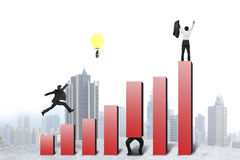 Businessman running and jumping on red bar chart, one cheered Stock Image