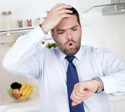 Businessman running late. For work Royalty Free Stock Photos