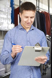 Businessman Running On Line Fashion Business With Clipboard Stock Image