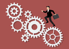 Businessman running on mechanism system Royalty Free Stock Photo