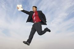 Businessman Running With Newspaper Royalty Free Stock Photography