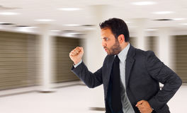 Businessman running in office because it is late Stock Photography