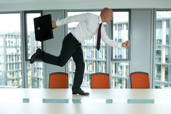 Businessman running on the office table Royalty Free Stock Image