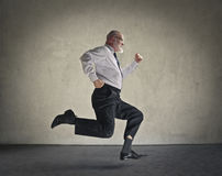 Businessman running royalty free stock photography