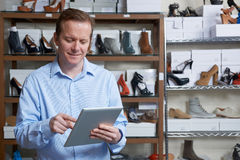 Businessman Running Online Shoe Business With Digital Tablet Stock Photography