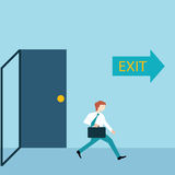 Businessman running out of a door with exit sign. Stock Photo
