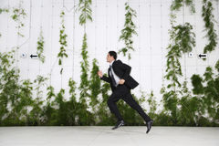 Businessman Running Outdoors Royalty Free Stock Photo