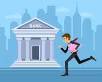 Businessman running with piggy-bank to bank with cityscape background Stock Photos