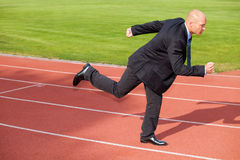 Businessman running on race track Royalty Free Stock Photography