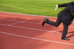 Businessman running on race track Stock Photography
