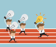 Businessman running on race track with bulb idea Royalty Free Stock Images