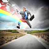 Businessman running on the road Royalty Free Stock Images