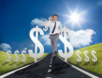 Businessman running on a road with dollar signs Royalty Free Stock Photos