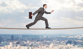 Businessman running on rope Royalty Free Stock Photo