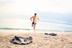 Businessman Running Into The Sea Stock Photo
