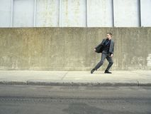 Businessman Running On Sidewalk Royalty Free Stock Images