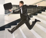 Businessman running on stair stock photography