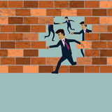 Businessman running though the breaked brick wall Royalty Free Stock Photography