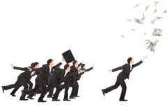Businessman running to the money Royalty Free Stock Photo