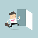 Businessman running to opened door Royalty Free Stock Images