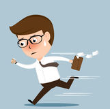Businessman running to work Stock Photography