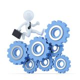 Businessman running on top of the gear mechanism. Business concept. Contains clipping path. Businessman running on top of the gear mechanism. Business concept Stock Photography