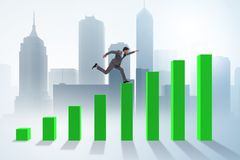 The businessman running towards economic success Stock Image