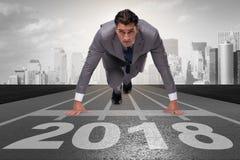 Businessman running towards new year  2018 Royalty Free Stock Photos
