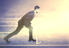 Businessman on running track royalty free stock image