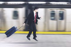 Businessman running in the train transportation Royalty Free Stock Photo