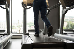 Businessman Running On Treadmill In Gym Royalty Free Stock Image