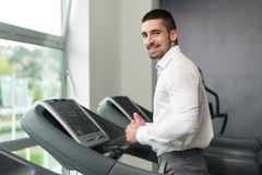 Businessman Running On Treadmill In Gym Royalty Free Stock Photo