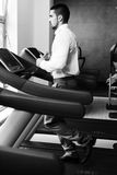 Businessman Running On Treadmill In Gym Royalty Free Stock Images