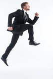 Businessman running up imaginative stairs Royalty Free Stock Photography