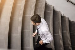Businessman running up stairway going to work stock photography