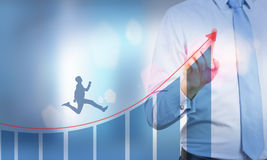 Businessman running upward Stock Images