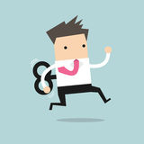 Businessman running with wind-up key Royalty Free Stock Images