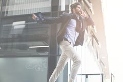 Businessman running on work. Young Businessman running on work Royalty Free Stock Photos