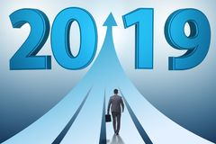 The businessman running into year of 2019 stock illustration